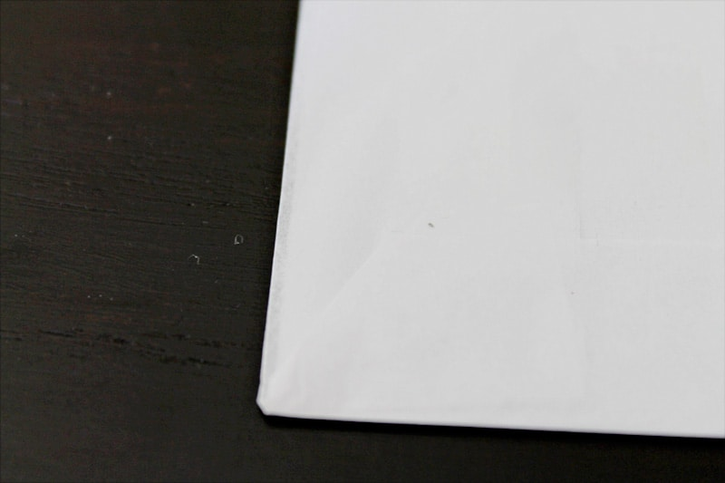 Taping up the tissue paper on top of the copy paper.