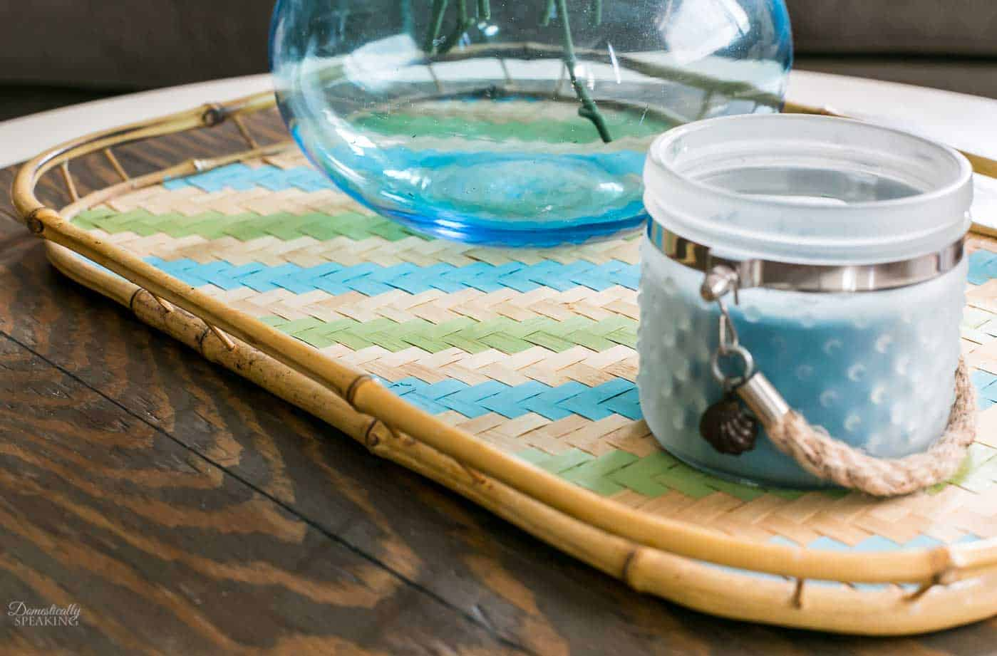 Thrift Store rattan tray is made over with paint into a striped painted tray in blue and green, perfect for Spring!