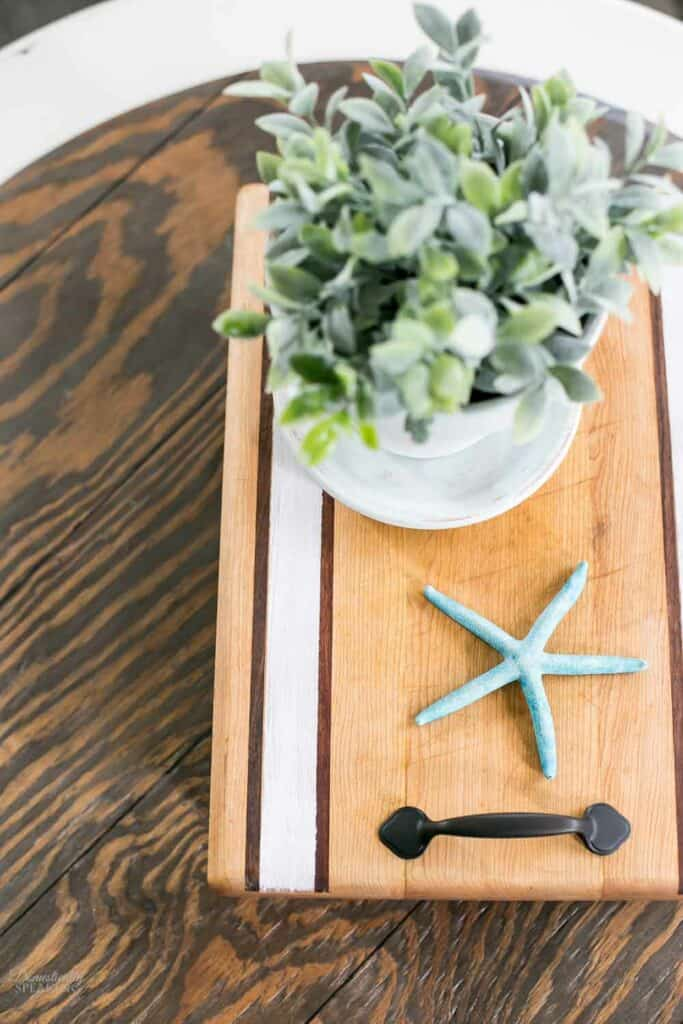 Striped wood tray with handles.