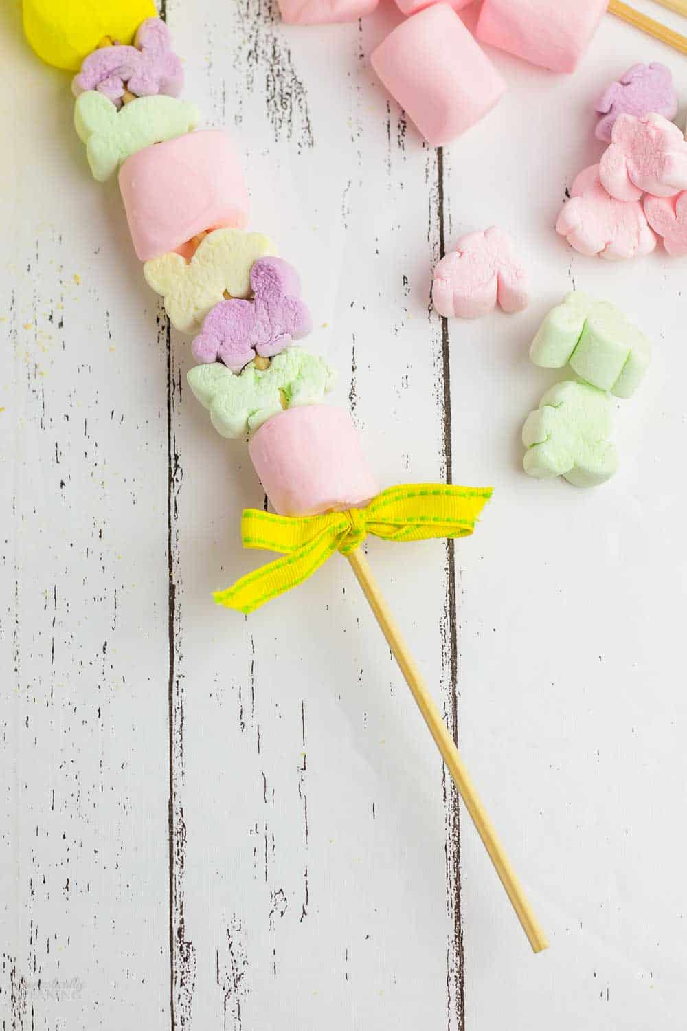 Marshmallows and ribbon on a skewer