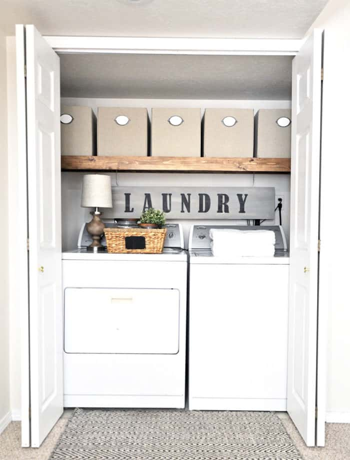 laundry room with wood shelf and buckets