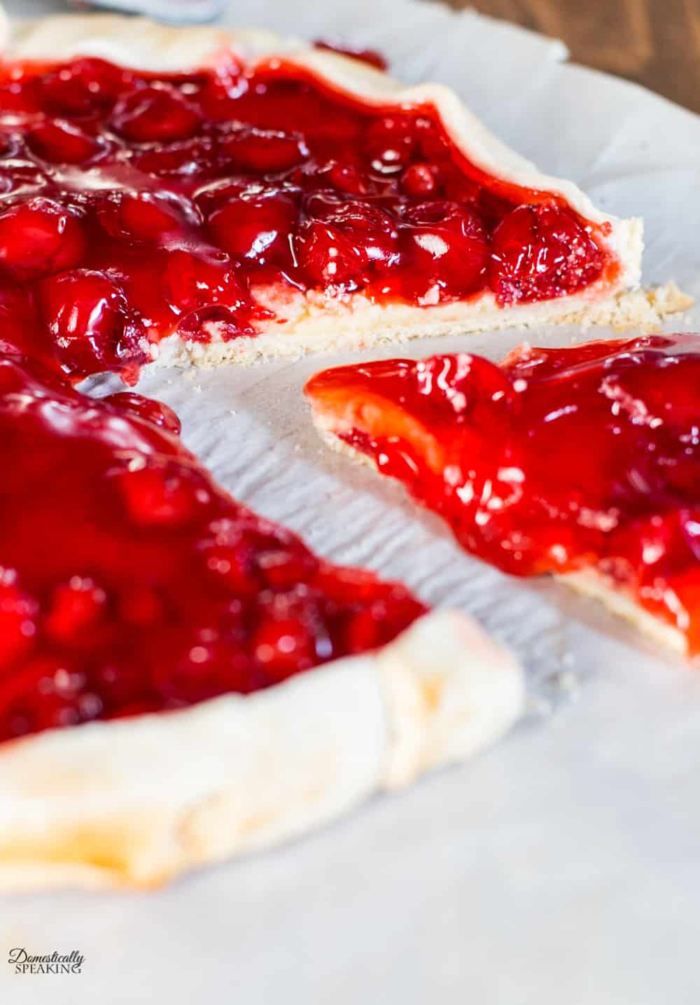 Flakey pie crust, almond cream cheese filling topped with delicious cherry pie filling - the perfect summer dessert!