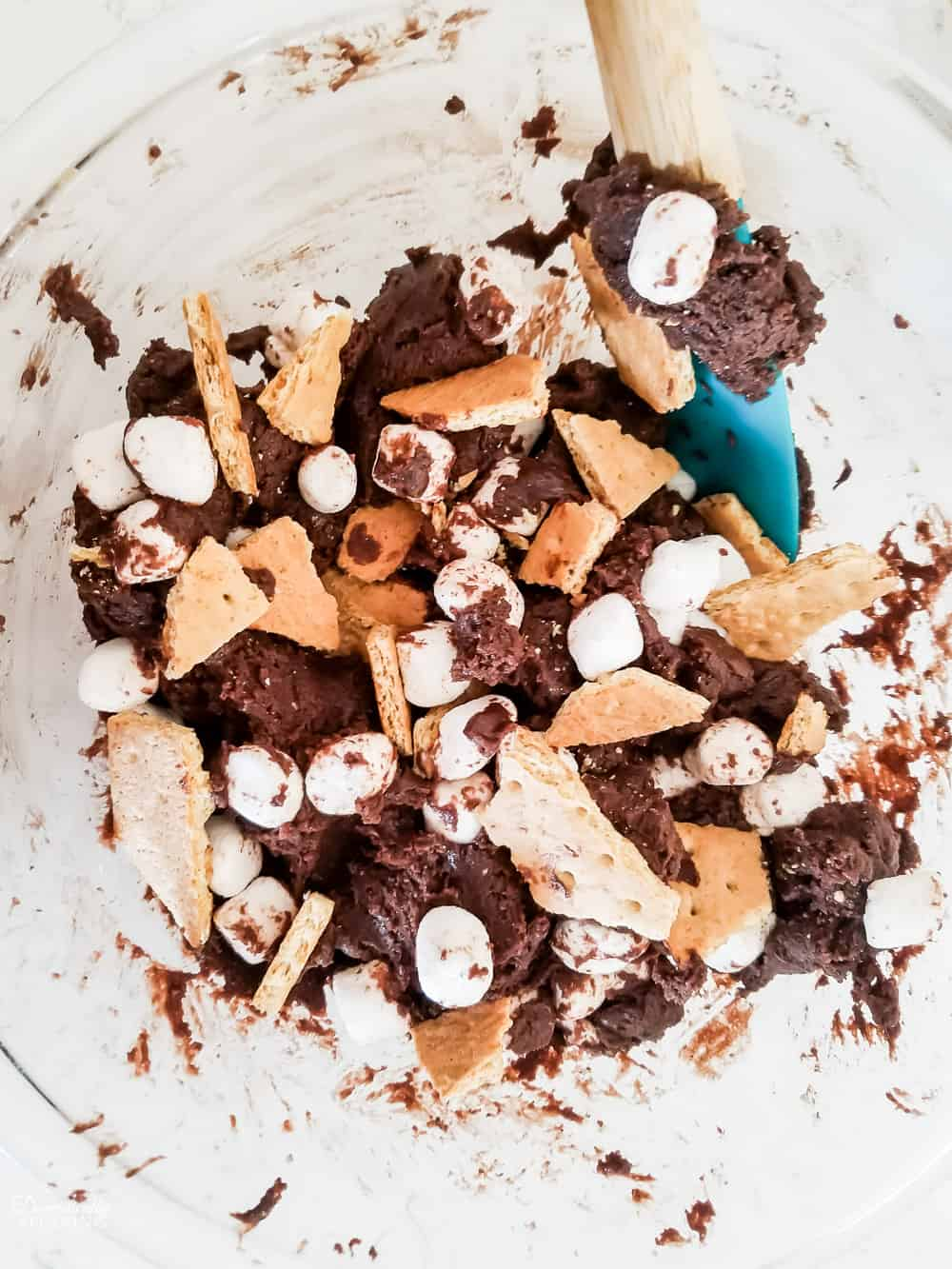Adding the mini marshmallows and chunks of graham crackers.