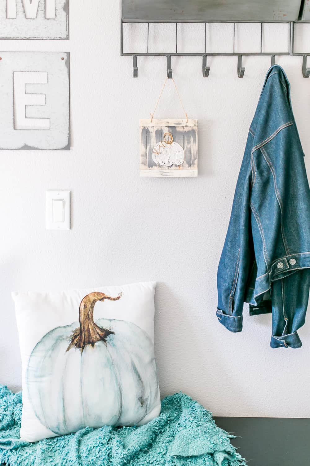 DIY Twine Pumpkin Sign hanging in a fall mudroom.
